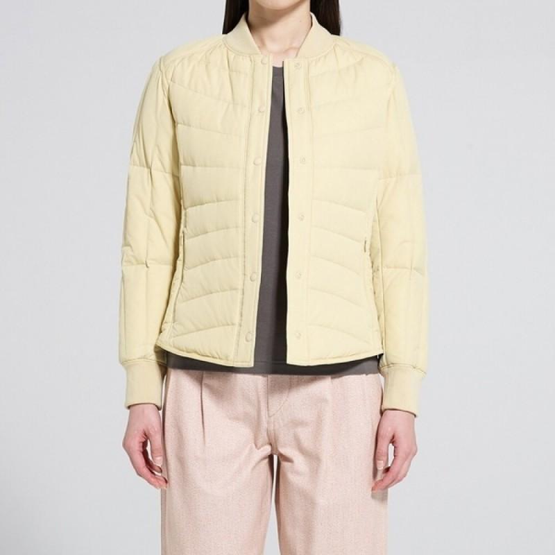 Желтая куртка на пуху Uniqlo
