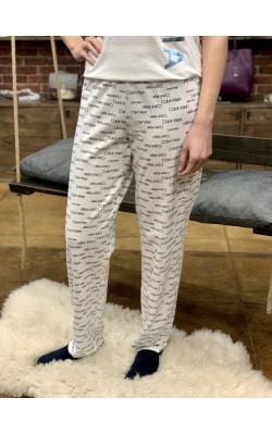 Белые штаны в лого Calvin Klein