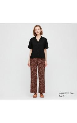 Черно-коричневые широкие штаны черные в цветы Uniqlo